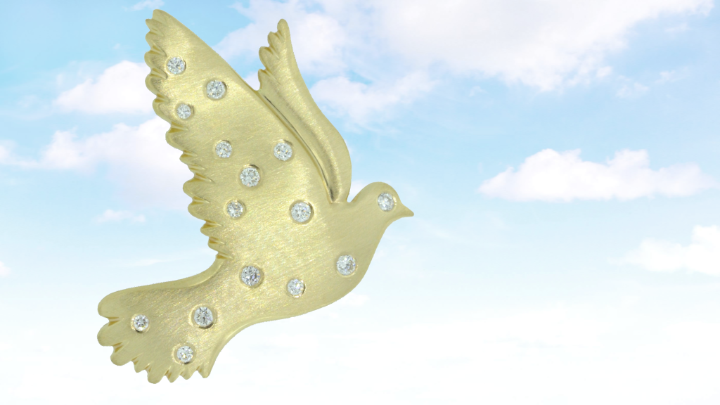 A picture of the 14K karat yellow and diamonds dove pin flying against a background of blue sky and clouds.