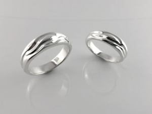 Picture of Summer Stream wedding bands in sterling silver standing up