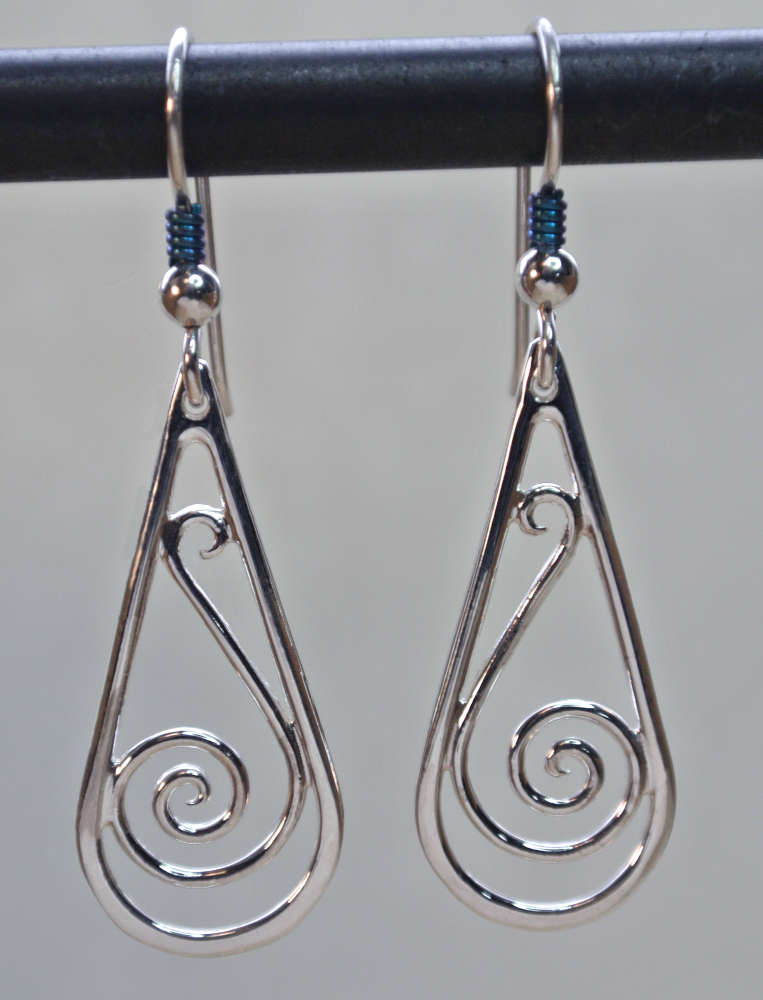 Picture of sterling teardrop shape wire scroll, or spiral dangles. Has a ball and niobium coil french wire.